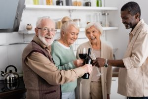Group of seniors gathers for a glass of wine