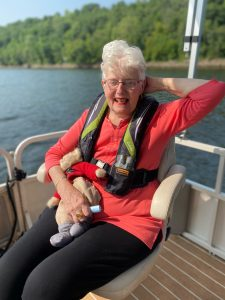 Dementia care patient enjoying a day on the lake