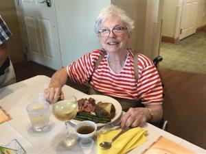 independent living elder enjoys a steak dinner