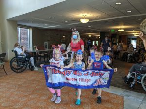 Kids visit senior living facility for 4th of July